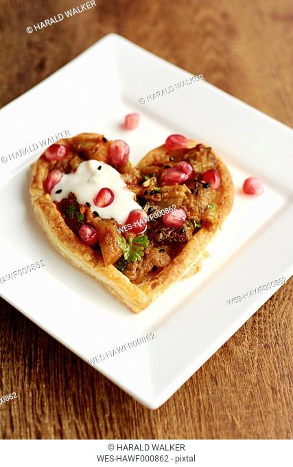 Heart shaped puff pastry tarts with eggplant and pomegranate arils