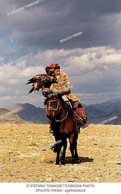 eagle hunters at golden eagle festival, bayan, olgii, mongolia