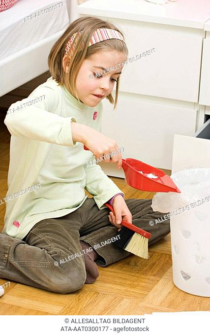 Girl is cleaning her room