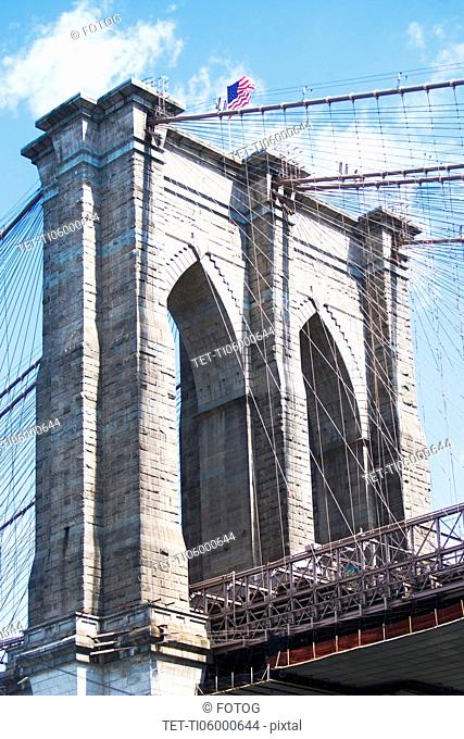 USA, New York State, New York City, Brooklyn bridge detail with American flag on top