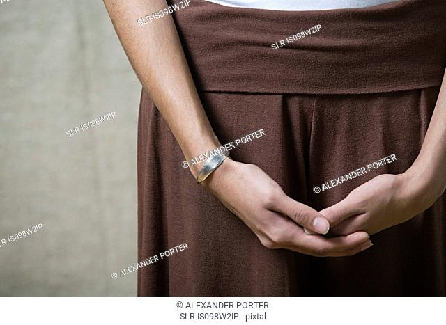 Woman with hands clasped, close up