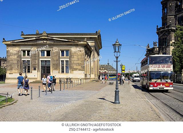 A double-decker for sightseeing tours appoaches in the city of Dresden, Saxony, Germany