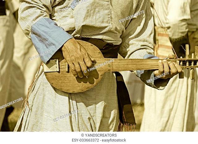 Yobin man with his traditional guitar at Namdapha Eco Cultural Festival, Miao, Arunachal Pradesh, India