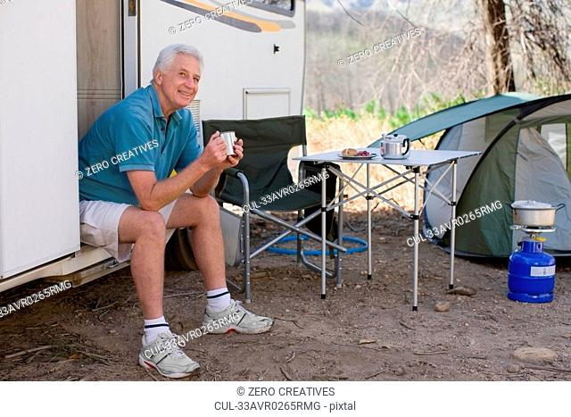 Older man camping with RV
