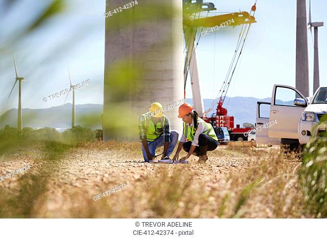 Engineers reviewing plans at turbine power plant
