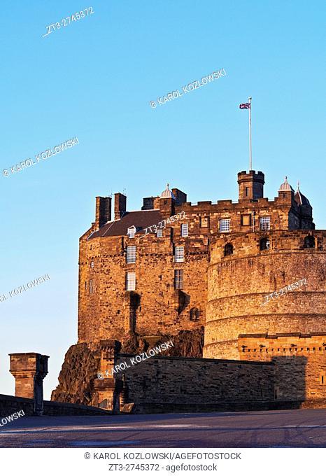 UK, Scotland, Lothian, Edinburgh, View of the Edinburgh Castle illuminated by the sunrise.