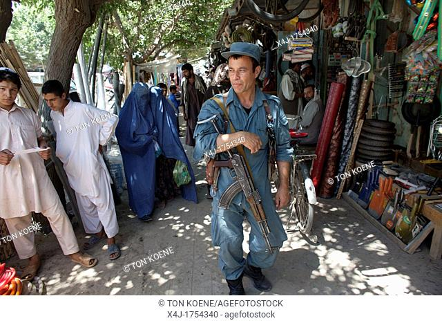 Afghan national Police officers walking patrol in Khanabad, Kunduz  Dutch military are supervising them