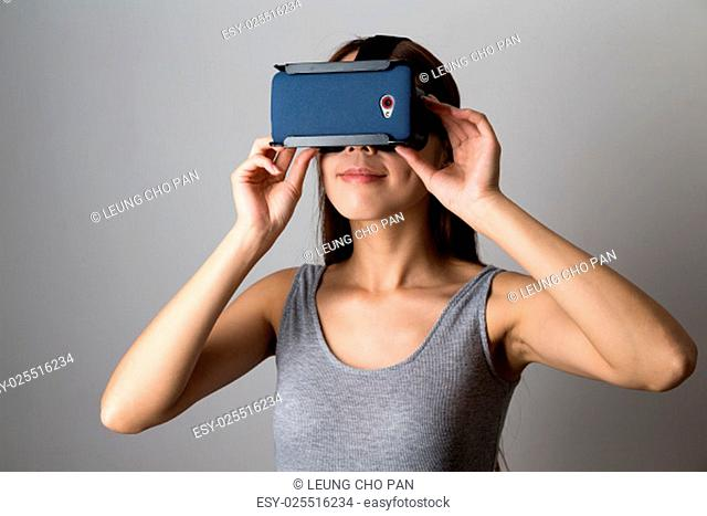 Young Woman using the virtual reality equipment