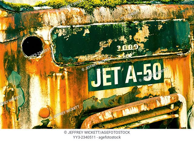 Front end of a rusty old jet fuel truck parked in a gravel pit near Sitka, Alaska