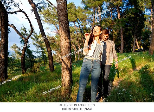 Young couple strolling in coastal forest, Split, Dalmatia, Croatia