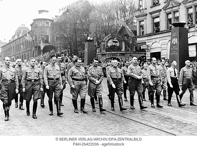 Adolf Hitler (m), Hermann Göring (4-l) and Ulrich Graf (6-l) march towards the Feldherrenhalle to commemorate the Beer Hall Putsch of November 1923 in Munich