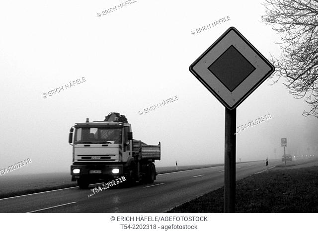 Truck driving from a fog wall