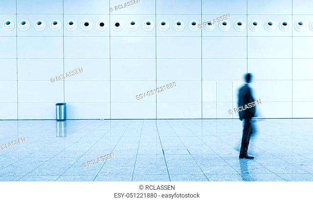 blurred businessman walking at a floor. ideal for websites and magazines layouts