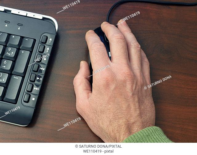 man's hand on mouse
