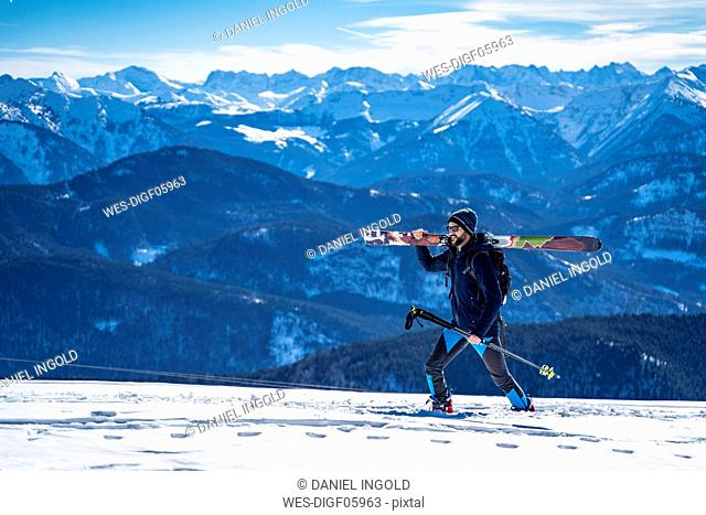 Germany, Bavaria, Brauneck, man on a ski tour in winter in the mountains