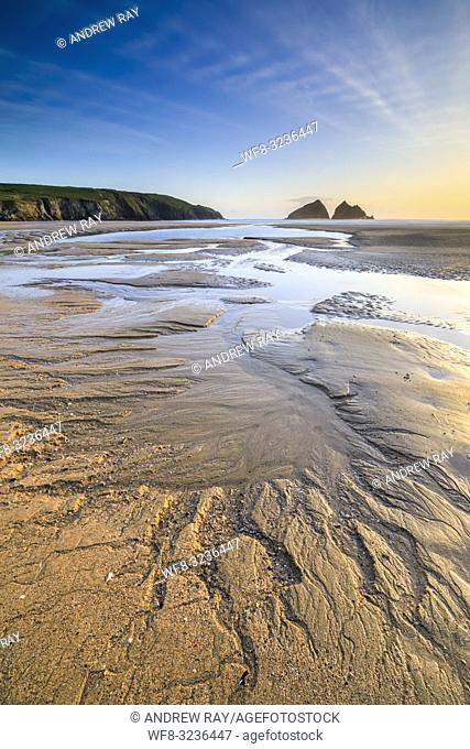 Sand patterns on the beach at Holywell Bay on the North Coast of Cornwall captured shortly before sunset on an evening in May