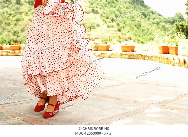 Woman flamenco dancing outdoors close-up