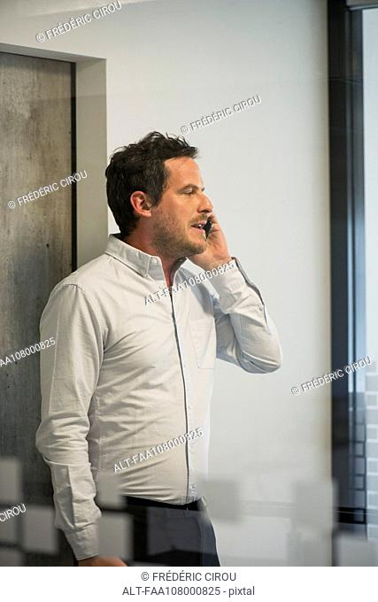 Man using office telephone
