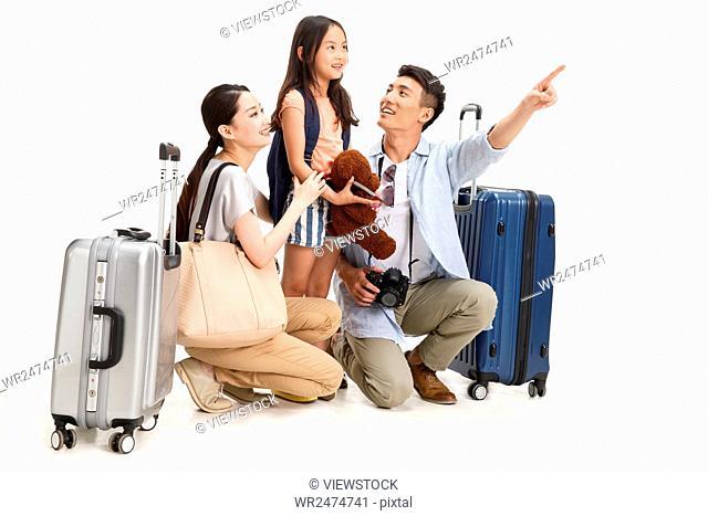 A family of three happy travel
