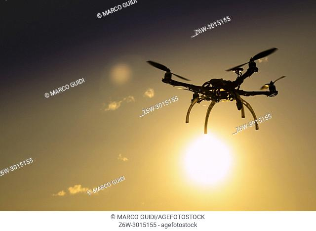 Photographic representation of the flight of a drone at sunset