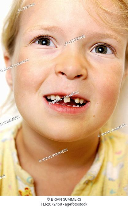 Girl With Loose Tooth