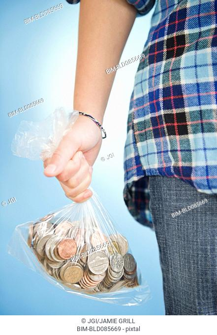 African American girl holding sack of coins