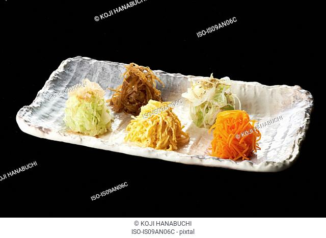Dish with grated vegetable stacks