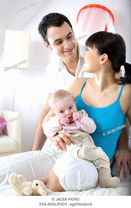 portrait of parents with infant