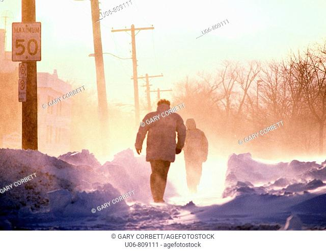 people walking on a cold winter day in blizzard conditions