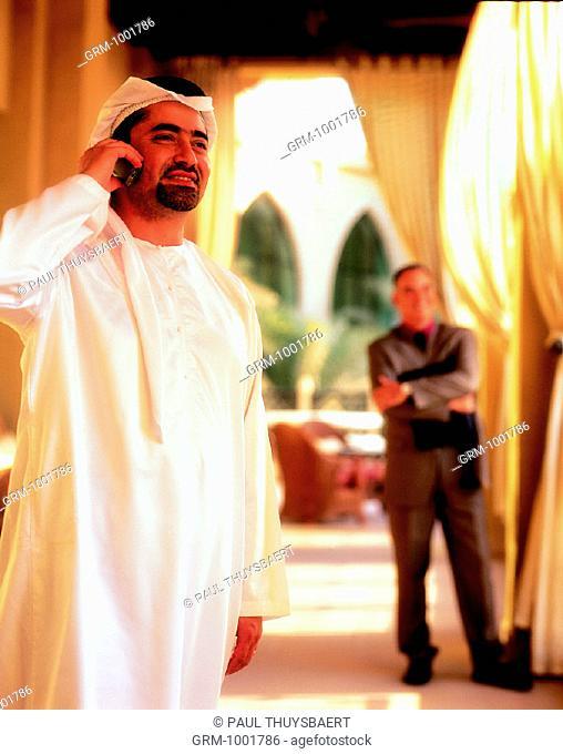 Arab businessman speaking on cell phone