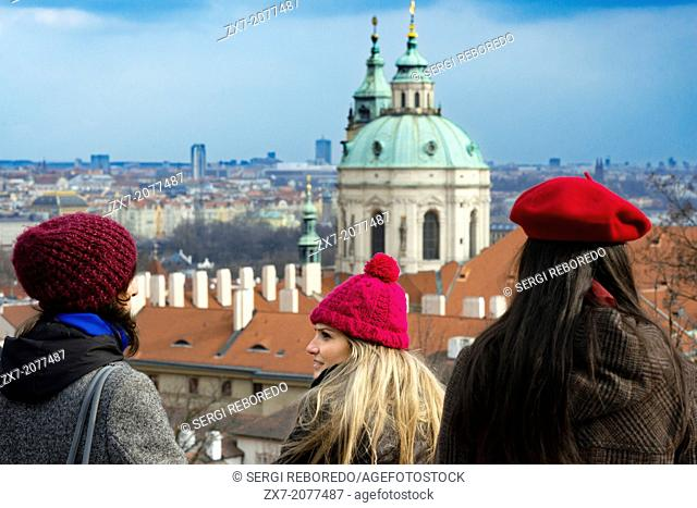 Views of the Church of St. Nicholas and the neighborhood of Mala Strana from the Prague Castle. Getting lost in Mala Strana, in the evening a winter month