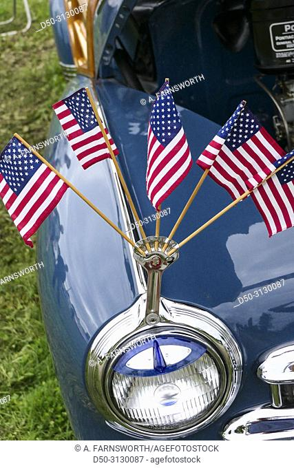 Goshen, Connecticut USA American flags on the headlights of a classic car at the annual classic car show at the Litchfield County Fairgrounds