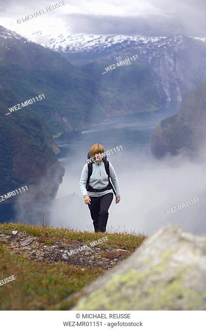 Norway, Fjord Norway, Aurlandsfjord, Woman hiking