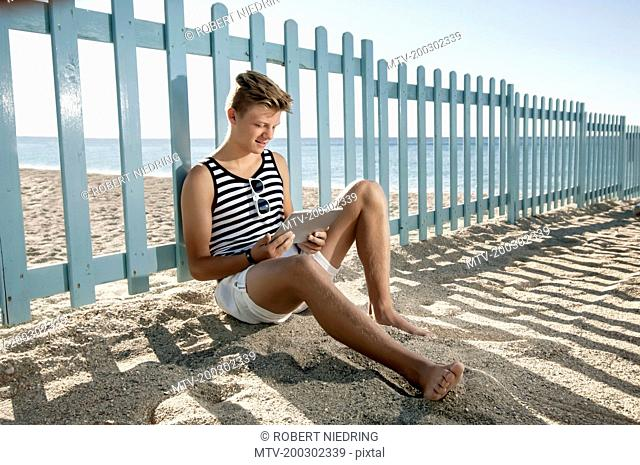 Beach summer holiday teenager tablet computer