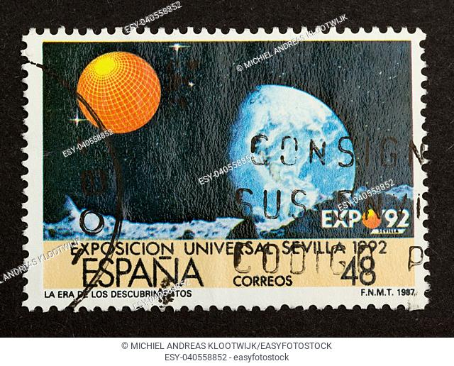 SPAIN - CIRCA 1980: Stamp printed in Spain shows the exposition (Universe) at Sevilla 1992, circa 1980