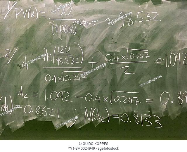 Tilburg, Netherlands. Notes and calculations, left behind on a green blackboard inside a Tilburg University College class room