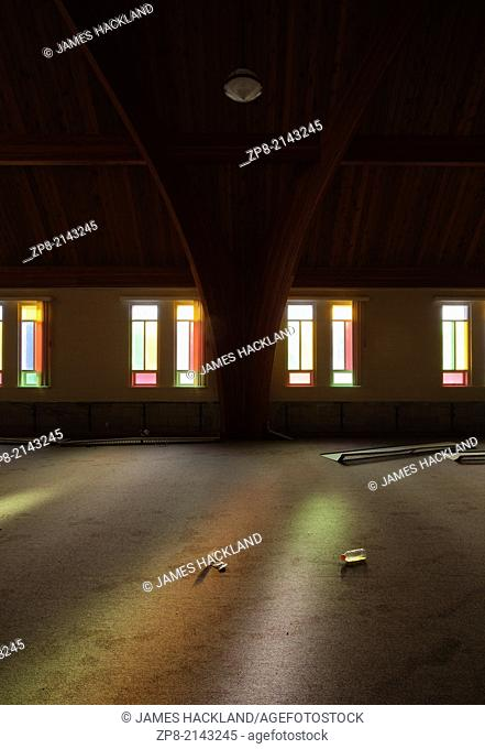 Colourful light pours through stained glass windows in the Harvest Bible Chapel in Oakville, Ontario, Canada. This Church has been demolished so there is no...