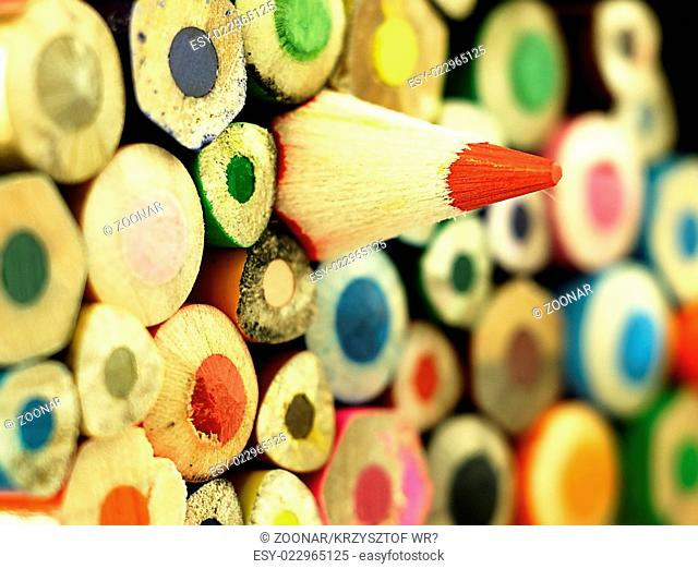 Colorful wooden crayons closely