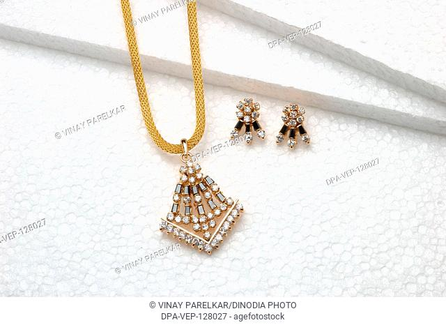 Diamond jewellery pendant with earring set in gold diamond with black sapphire black onyx