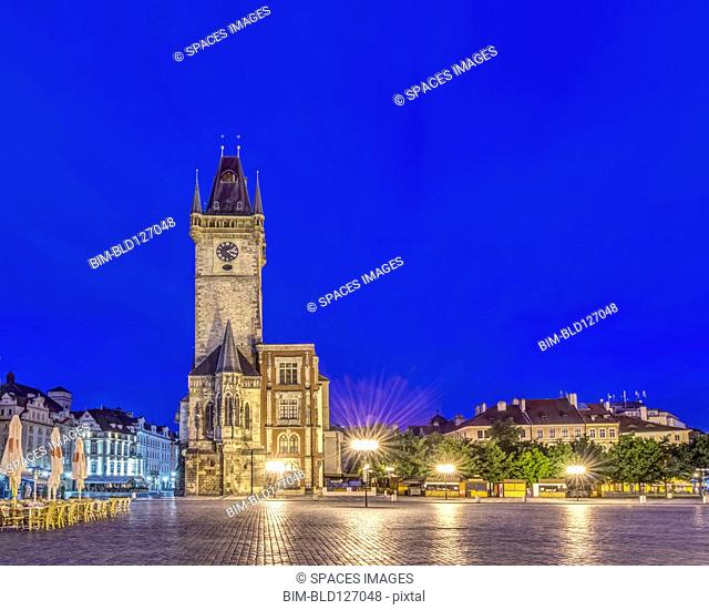 Illuminated piazza and old town hall at dawn, Prague, Czech Republic