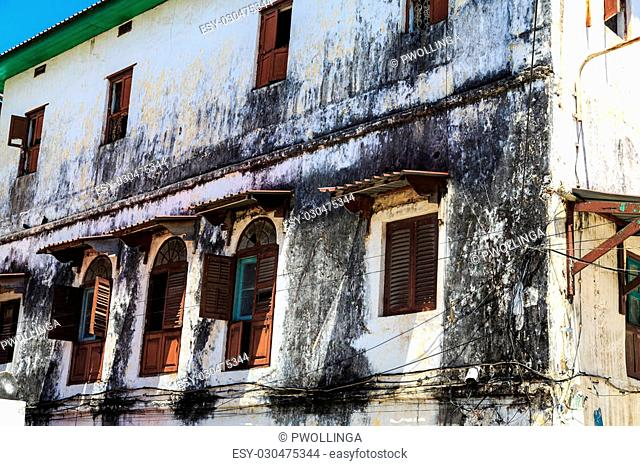 Old colonial facade of a building in a street in Stone Town, Zanzibar
