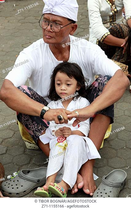 Indonesia, Bali, Mas, temple festival, father and daughter, odalan, Kuningan holiday