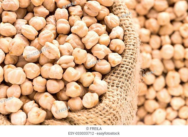 horizontal selective focus of chickpeas with hessian sack full frame ,copy space and room for text over blurred right side, ideal for Pinterest or blogs