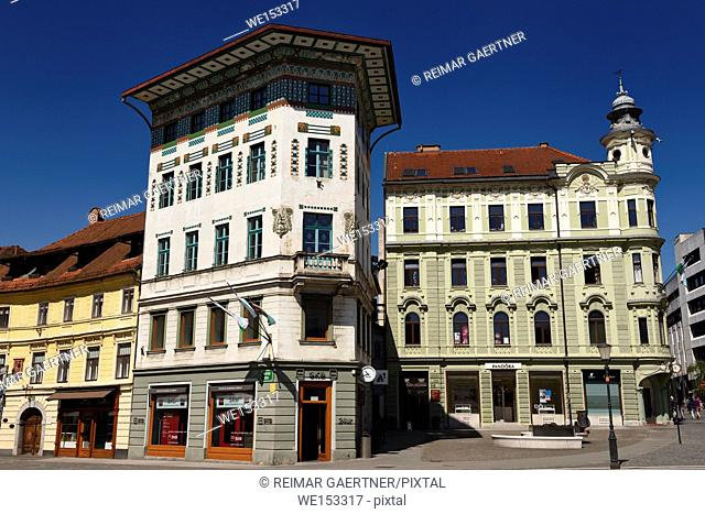 Historic Art Nouveau buildings at Preseren Square white tiled Hauptmann House 1873 left and green Frisch house 1897 Ljubljana Slovenia
