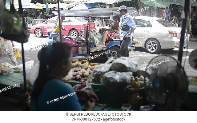 Woman seller of lotus flowers in Pak Khlong Talat , Flower market , Bangkok , Thailand. Pak Khlong Talat is a market in Bangkok, Thailand that sells flowers