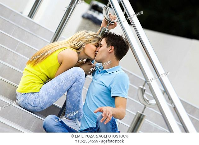 Stock Photo - Teens girl and boy passionate kiss on street