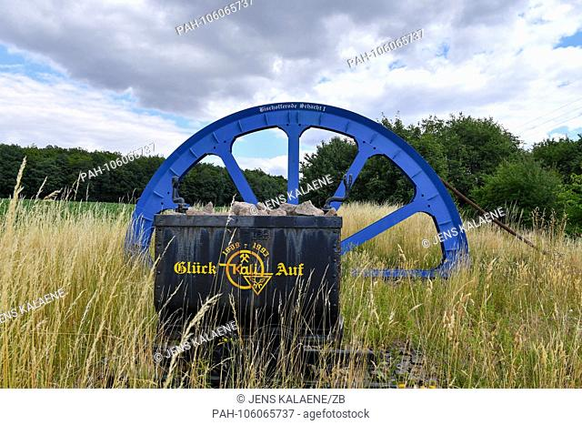 "27.06.2018, Bischofferode, Thuringen: A blue painted commuter wheel can be seen at the Schucktweg """"Gluck auf"""". Protests of the miners at the close of the..."