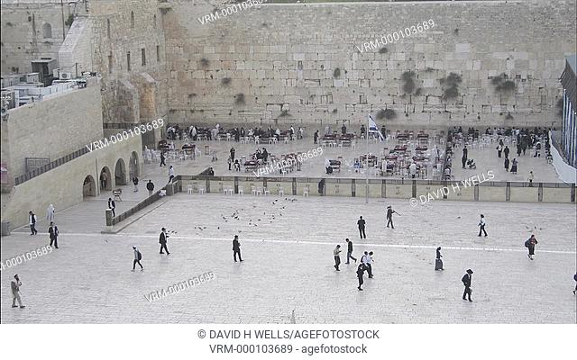 Time-lapse animation of Orthodox Jewish men praying at the Western Wall, the holiest shrine in the Jewish faith in Jerusalem, Israel