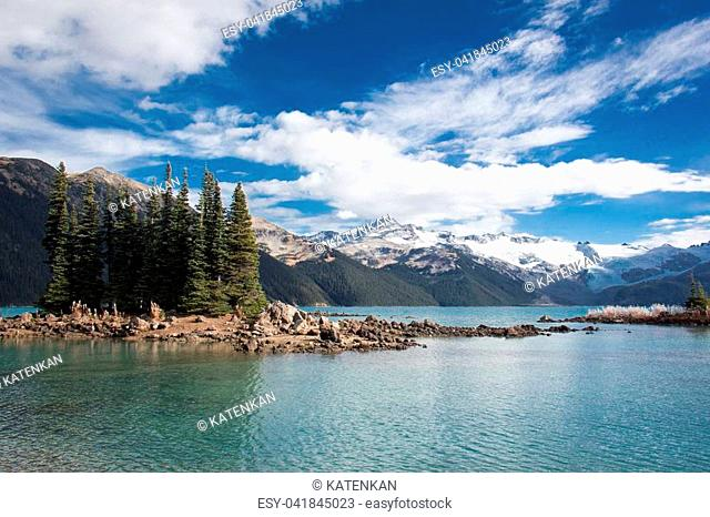 landscape view of garibaldi lake and snowy mountain tops in coast mountains of british columbia