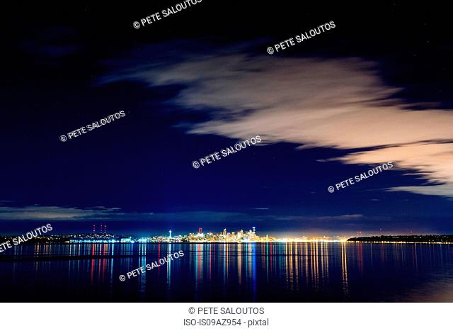 Distant skyline and city lights at night, Seattle, Washington, USA